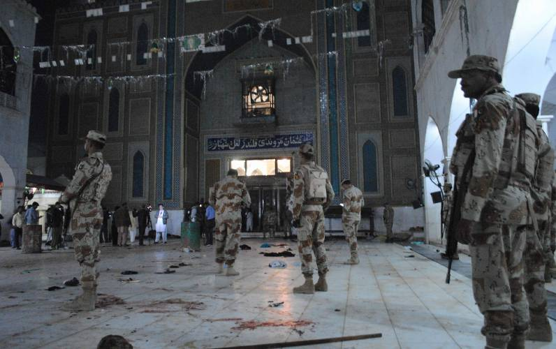 Islamic State suicide bombing at Pakistan shrine kills 75