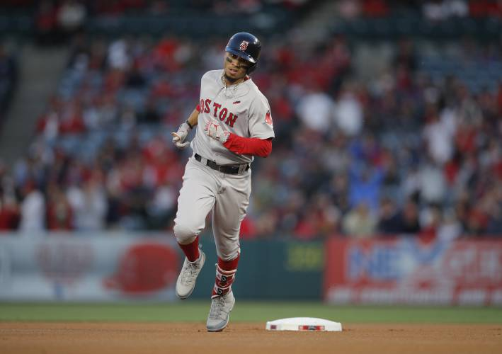 Betts hits 3 HR, Red Sox oust Angels' Ohtani early, win 10-1
