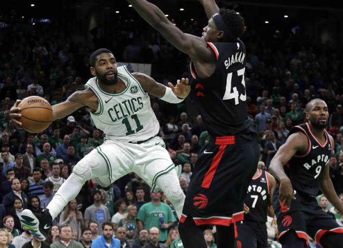 492cfc1a4a8e Boston Celtics guard Kyrie Irving (11) passes the ball against the defense  of Toronto Raptors forwards Pascal Siakam (43) and Serge Ibaka (9) in the  fourth ...