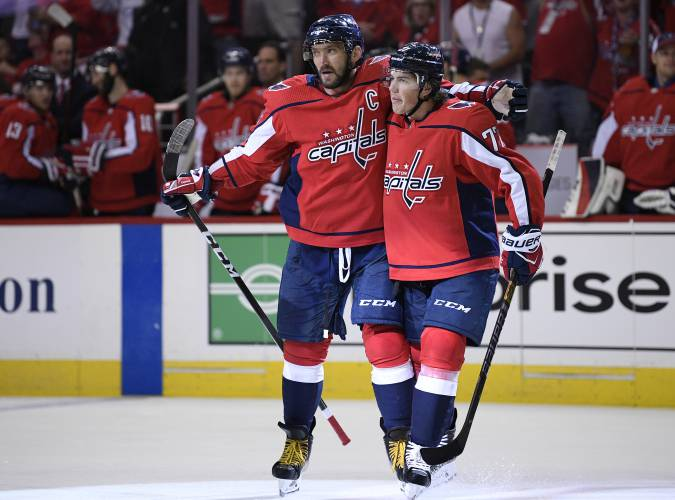 cadc1313450 Capitals open Stanley Cup defense with 7-0 rout of Bruins