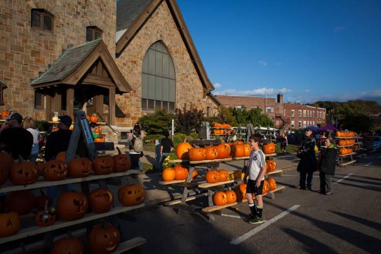 Jack-o-lanterns glow at Laconia Pumpkin Festival