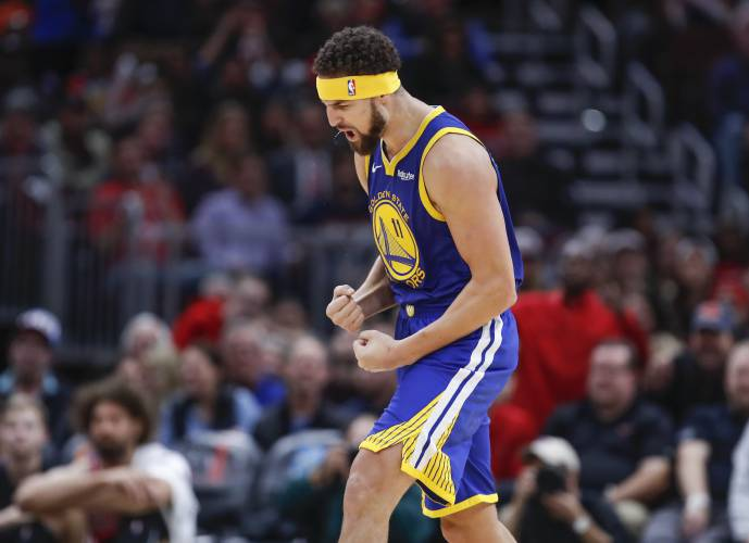 5b41f69db0a5 Golden State Warriors guard Klay Thompson celebrates after scoring a three  pointer against the Chicago Bulls during the second half of an NBA  basketball ...