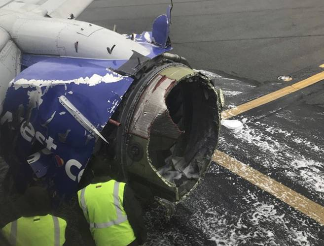 Southwest Airlines jet blows an engine; woman dies after being nearly sucked out