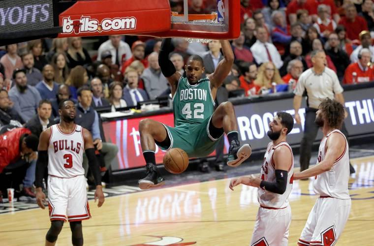 Thomas scores 33, Celtics beat Bulls 104-95 to tie series