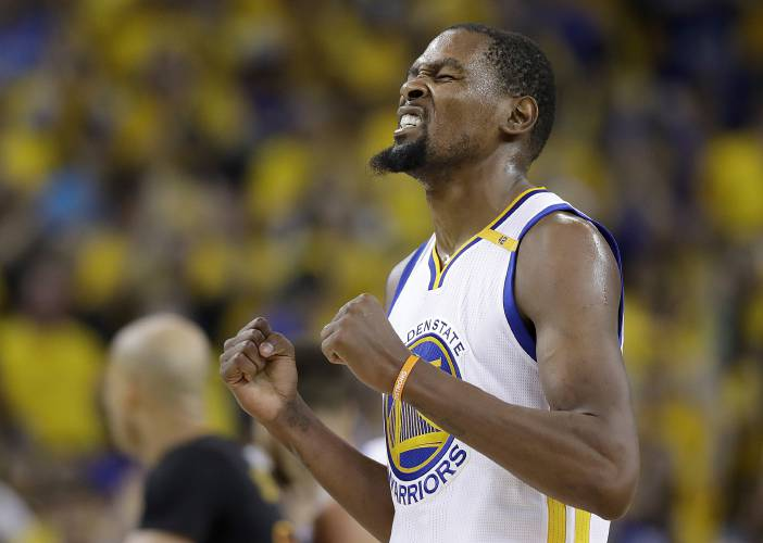 ... Golden State Warriors forward Kevin Durant reacts after scoring against  the Cleveland Cavaliers during the second half of Game 5 of basketball\u0027s  NBA ...