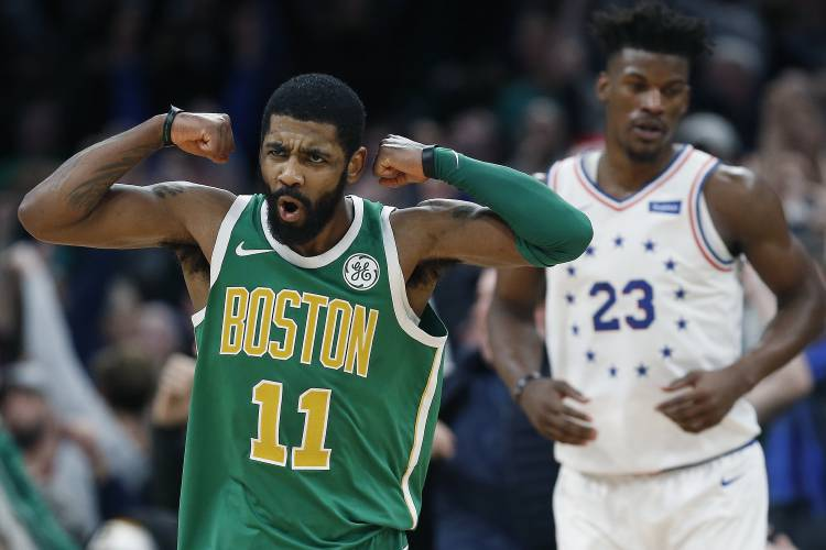 12465cf49 Boston Celtics  Kyrie Irving (11) reacts in front of Philadelphia 76ers  Jimmy  Butler after making a 3-pointer in overtime during an NBA basketball game in  ...