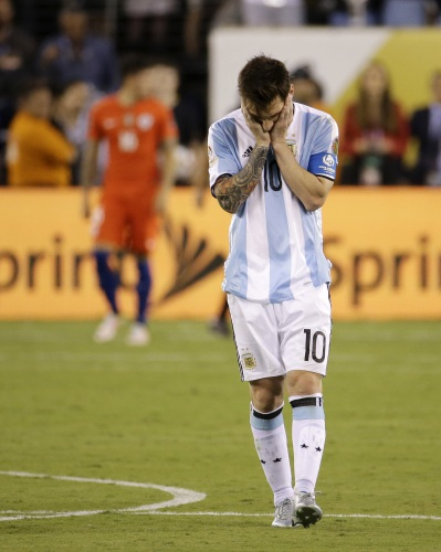 35b8bee4b Argentina s Lionel Messi reacts after missing his shot during penalty kicks  in the Copa America Centenario championship soccer match
