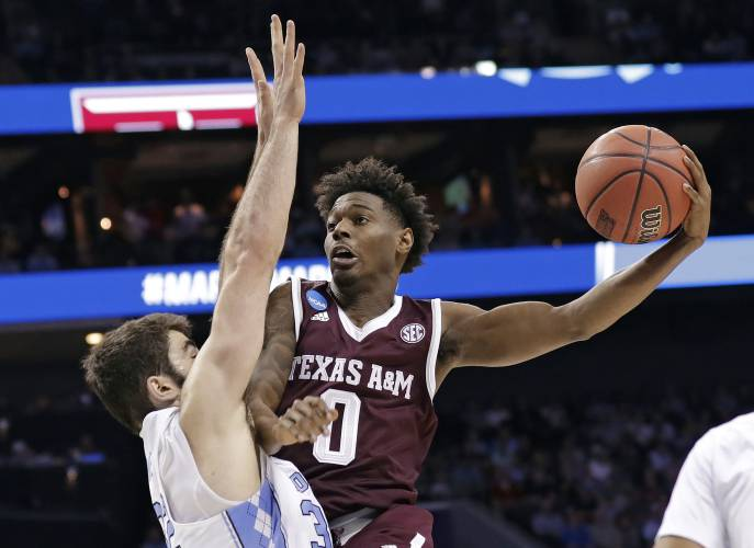 94f390ecbb97e2 Texas A M s Jay Jay Chandler (0) drives against North Carolina s Luke Maye  (32) during the first half of a second-round game in the NCAA men s college  ...