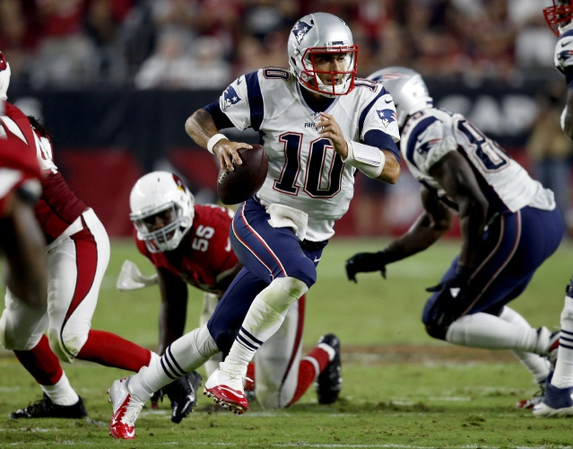 Jimmy Garoppolo scrambles during Sunday s win over Arizona. Garoppolo led the  Patriots to victory with 264 yards passing and a touchdown. AP a74b2f6e7