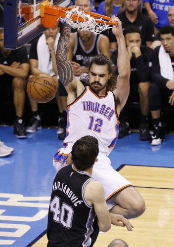 4ac3172a65ec Oklahoma City Thunder center Steven Adams (12) dunks over San Antonio Spurs  center Boban Marjanovic (40) in the second quarter of Game 6 of a second-round  ...