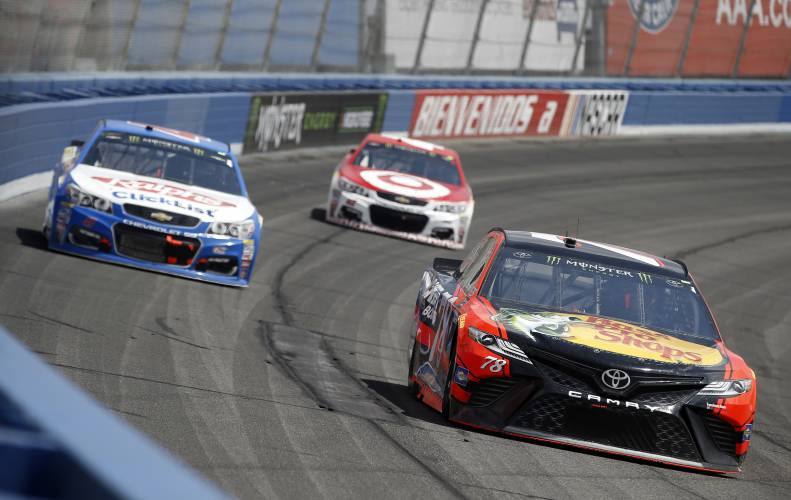 Second to none kyle larson hangs on to win at fontana for Larson motors used cars