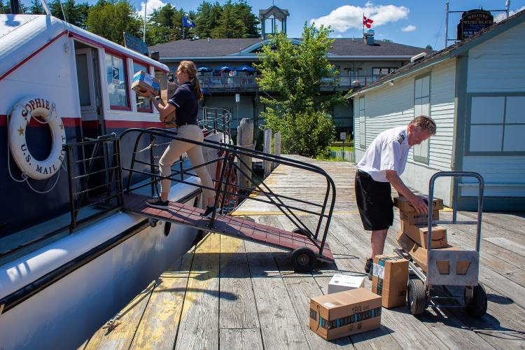 deck packages mail boat on winnipesaukee brings island residents together