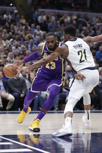 8609495dcd07 Los Angeles Lakers forward LeBron James (23) drives on Indiana Pacers  forward Thaddeus Young (21) during the first half of an NBA basketball game  in ...