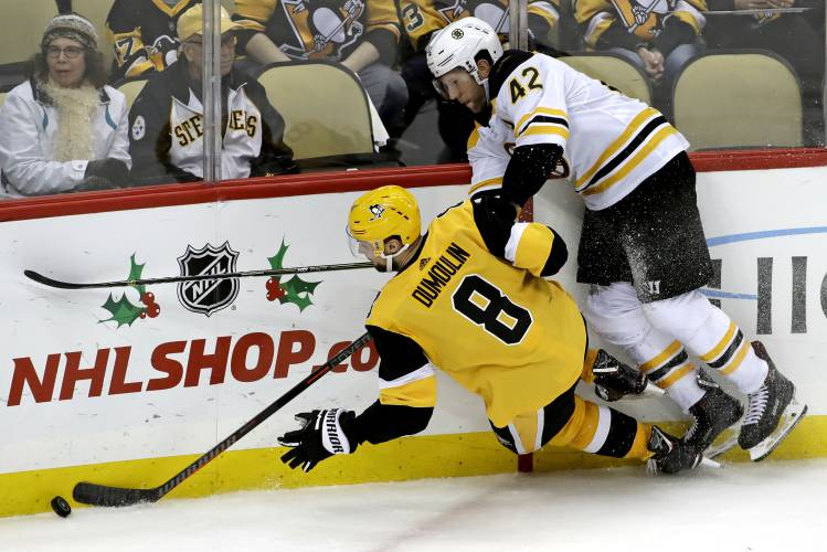 Boston Bruins  David Backes (42) collides with Pittsburgh Penguins  Brian  Dumoulin (8) during the third period of an NHL hockey game in Pittsburgh 8ea7f460c