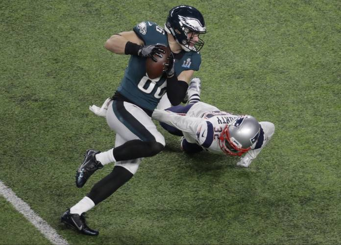 5bd3ee58f54 Philadelphia Eagles tight end Zach Ertz scores past New England Patriots  free safety Devin McCourty during the second half of the NFL Super Bowl 52  football ...