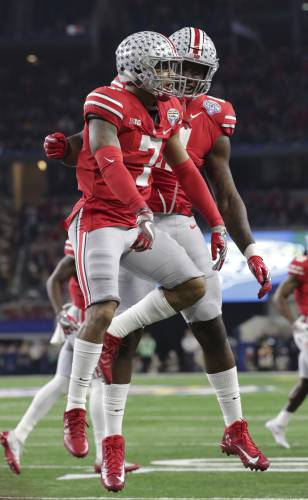 Playoff-snubbed Ohio State wins, 24-7, over USC in Cotton Bowl