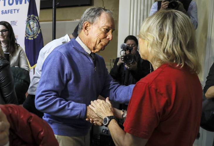 Former New York Mayor Michael Bloomberg Talks To A Woman Who Lost Her Daughter To Gun Violence After Speaking At A Rally At City Hall In Nashua N H