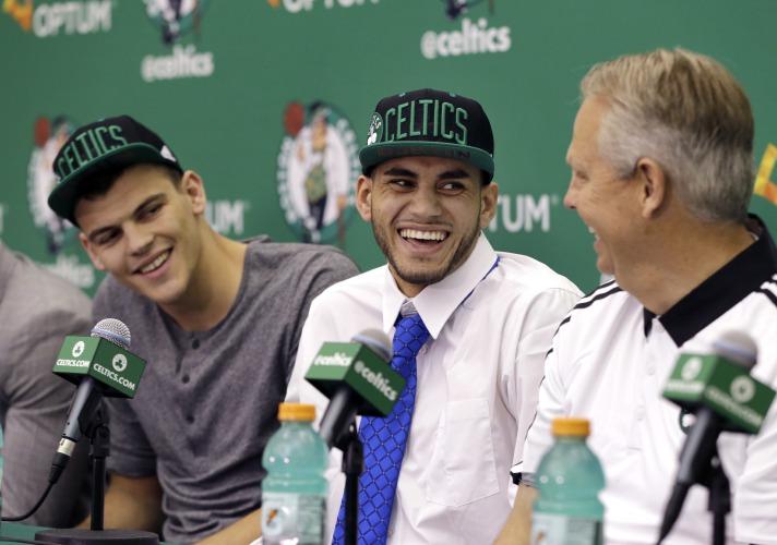 Boston Celtics basketball draft picks Ante Zizic, left, of Croatia, and  Abdel Nader, center, of Egypt, laugh with Danny Ainge, Celtics president of  ...