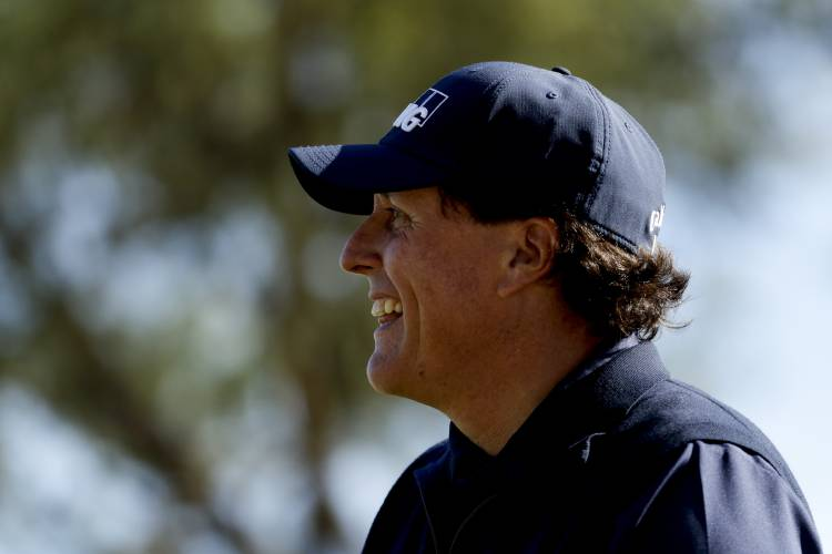 6d97473db5a Phil Mickelson smiles after his tee shot on the fourth hole during the  third round of the Desert Classic golf tournament on the Stadium Course at  PGA West ...