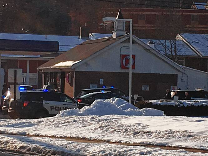 Heavy police presence seen at gas station on Pleasant St. in Concord
