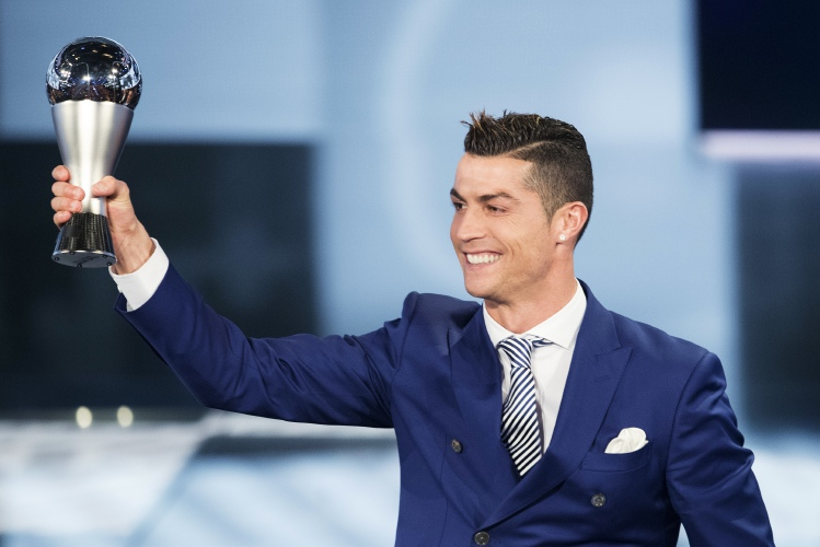 Cristiano Ronaldo of Portugal poses with the trophy after winning the FIFA  men s player award during the FIFA Football Awards 2016 ceremony held at the  ... 2d80a5238d133