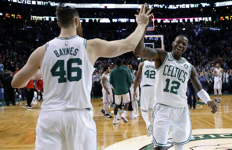 d08e7c62c9f7 Boston Celtics  Terry Rozier (12) and Marcus Smart (36) celebrate after  defeating the Houston Rockets in an NBA basketball game in Boston