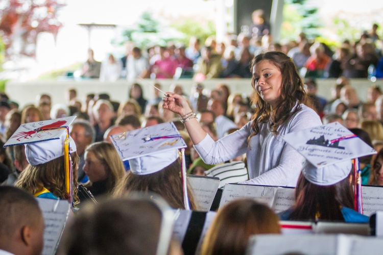 Lauren Fountain directs the Belmont High School band during the Belmont  High School graduation ceremony at the Bank of New Hampshire Pavilion in  Gilford on ...