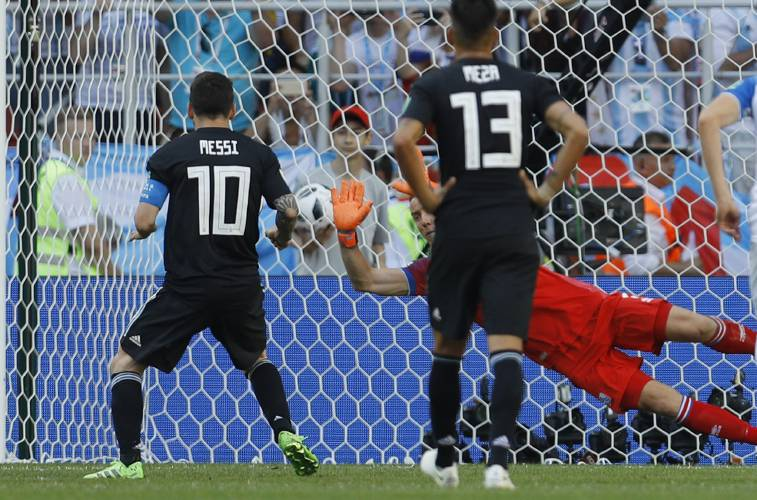 Iceland goalkeeper Hannes Halldorsson makes a save after a penalty shot by Argentina s  Lionel Messi (left) during the group D match between Argentina and ... 95a1d59a8ac33