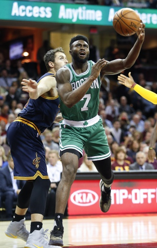 4bd78b9c1 Boston Celtics  Jaylen Brown (7) shoots against Cleveland Cavaliers  Kevin  Love (0) during the first half of an NBA basketball game Thursday