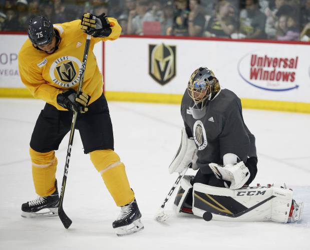 785b7ef75 Vegas Golden Knights goaltender Marc-Andre Fleury blocks a shot tipped by right  wing Ryan Reaves during an NHL hockey practice Wednesday, June 6, 2018, ...