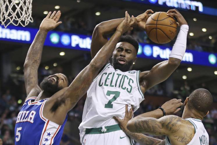 471d00389 Boston Celtics guard Jaylen Brown (7) pulls down a rebound over  Philadelphia 76ers center Amir Johnson (5) during the first quarter of Game  2 of an NBA ...