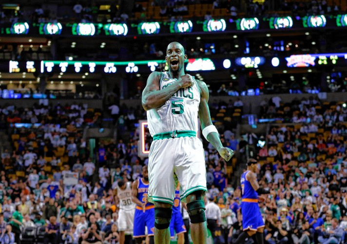 88c44c87de1 Black Fives branded jersey in green Boston Celtics center Kevin Garnett (5)  pounds his chest just before tap-off ...