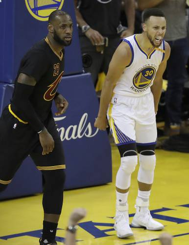 a0b198948 Golden State Warriors guard Stephen Curry (30) reacts after scoring next to  Cleveland Cavaliers forward LeBron James during the second half of Game 2 of  ...
