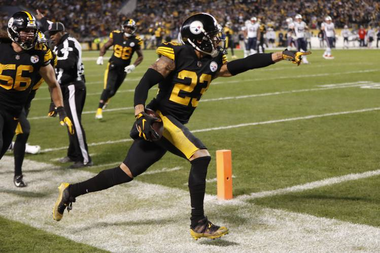 7cd11c06d Pittsburgh Steelers cornerback Joe Haden (23) celebrates after intercepting  a pass intended for New England Patriots wide receiver Julian Edelman  during the ...