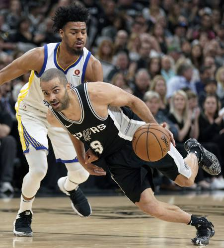 0d255877ff0 FILE - In this April 22, 2018, file photo, San Antonio Spurs' Tony Parker (9)  drives against Golden State Warriors' Quinn Cook during the second half of  ...