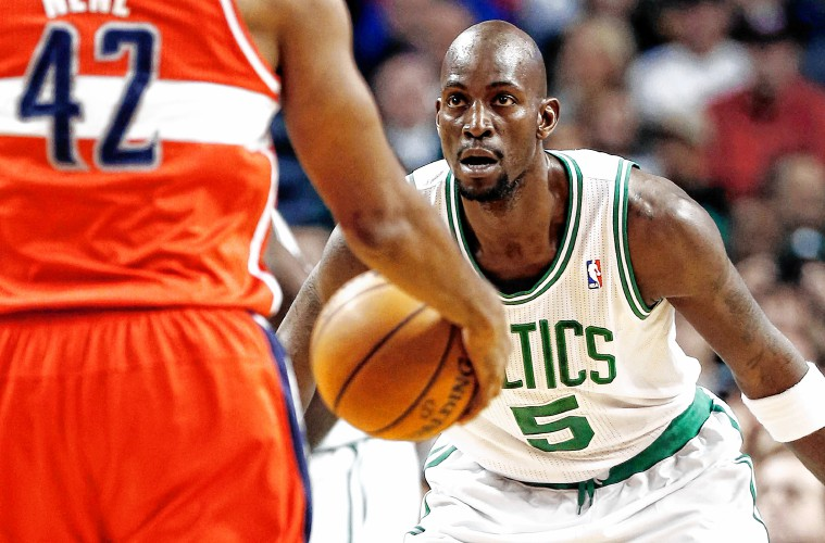 a1ea8bc5c44 ... Boston Celtics Kevin Garnett defends against Washington Wizards Nene  during the first quarter of their 107 ...