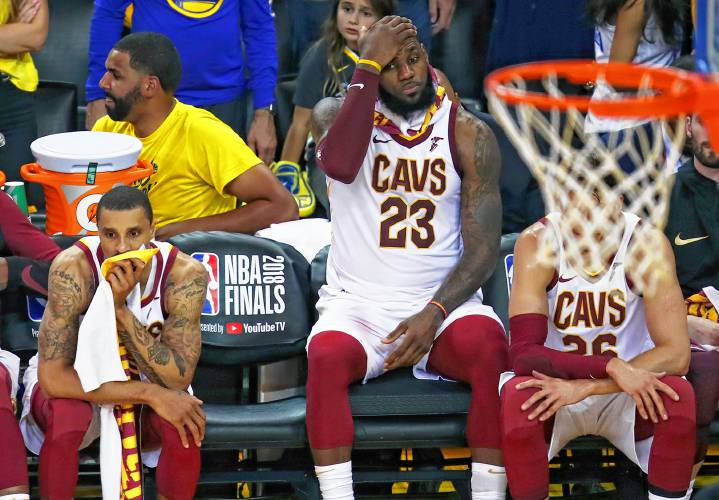 a2e15b5edbcb Cleveland Cavaliers forward LeBron James (23) sits on the bench between  guard George Hill