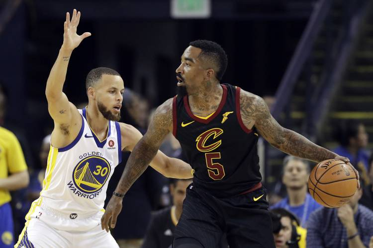 f8b1e9e192d Cleveland Cavaliers guard J.R. Smith (5) is defended by Golden State  Warriors guard Stephen Curry (30) during the first half of Game 1 of  basketball s NBA ...