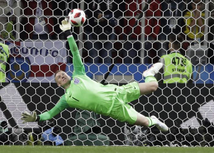 147472452 England goalkeeper Jordan Pickford saves a penalty during the round of 16  match between Colombia and England at the 2018 soccer World Cup in the  Spartak ...