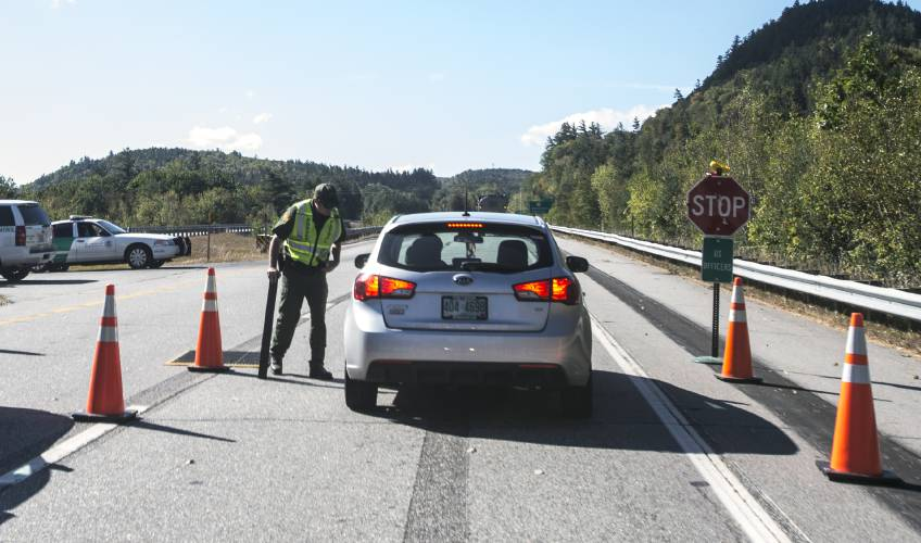a us border patrol agent checks a car on the i 93 southbound lane on wednesday september 28 2017 south of the route 175 exit south of lincoln