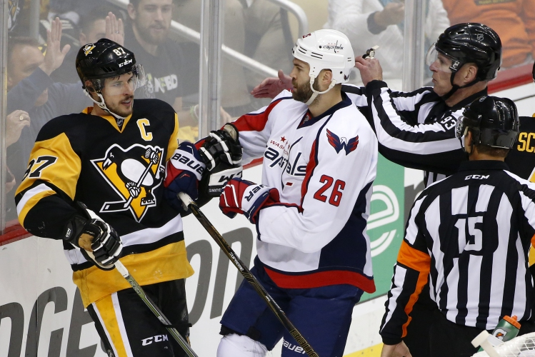 Washington Capitals  Daniel Winnik (26) shoves Pittsburgh Penguins  Sidney  Crosby (87) during the first period of Game 4 in an NHL hockey Stanley Cup  ... 58053e92df31
