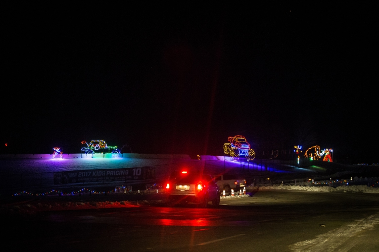 Cars drive past different scenes along the two-mile Christmas lights display called Gift of Lights at the New Hampshire Motor Speedway in Loudon on Friday, ...