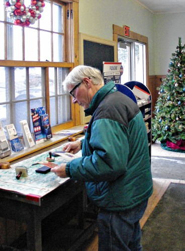 20 2016 photo provided by christopher jensen larry steigleman of littleton nh handles mail at the post office in bethlehem nh on the counter - Post Office Hours Christmas Eve