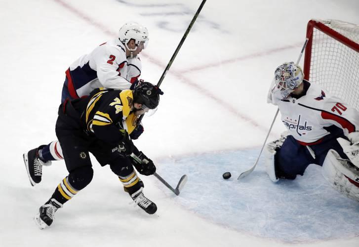 3a43403f3a9 Washington Capitals goaltender Braden Holtby (70) makes a stick save  against Boston Bruins left wing Jake DeBrusk (74) as Capitals defenseman  Matt Niskanen ...