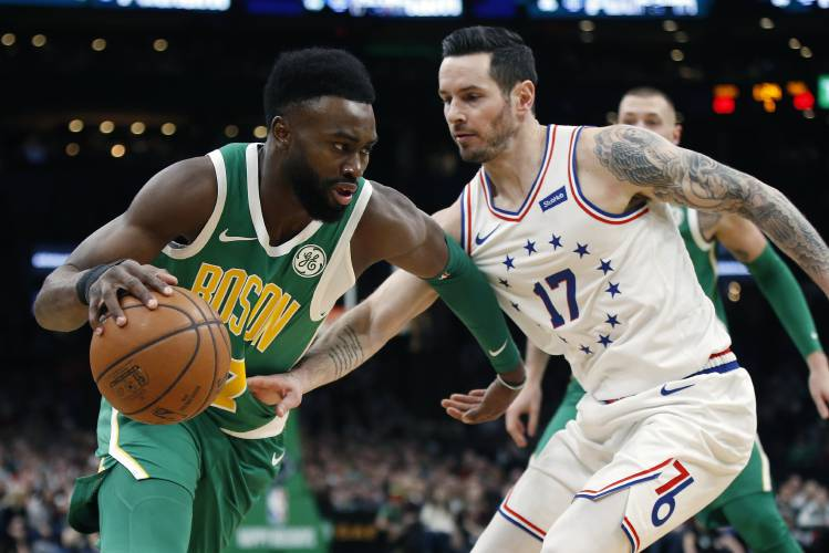 1834cfe22 Boston Celtics  Jaylen Brown (7) is defended by Philadelphia 76ers  JJ  Redick (17) during the first half of an NBA basketball game in Boston