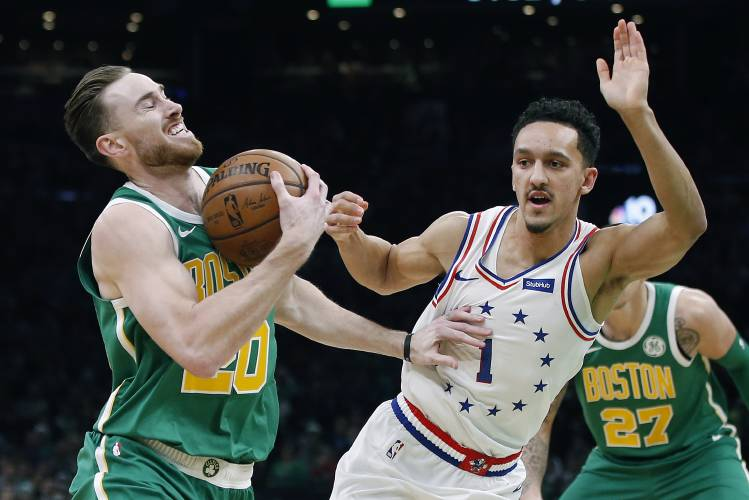 811a3fac9 Boston Celtics  Gordon Hayward (20) is defended by Philadelphia 76ers   Landry Shamet (1) during the first half of an NBA basketball game in  Boston