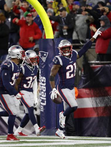 8db7b21965e New England s Duron Harmon (21) celebrates in front of the Gillette Stadium  crowd after a Dec. 2 interception against Minnesota. Harmon and the  Patriots are ...
