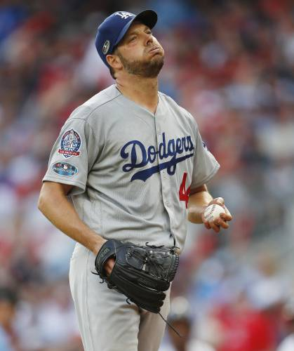 Machado, Dodgers finish off Braves in NLDS with 6-2 win