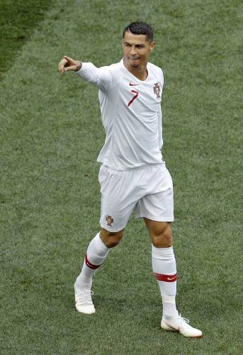 Portugal s Cristiano Ronaldo celebrates after scoring the opening goal  during the group B match between Portugal and Morocco at the 2018 soccer  World Cup in ... 1f2ea6da5