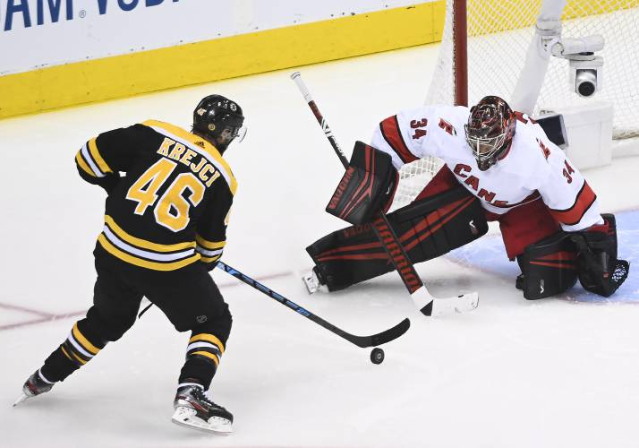 Bergeron scores in 2nd OT; Bruins beat Hurricanes in Game 1